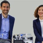 Frank and Ana cofounders of Bionomous together with the eggsorter and the logo of FIT.