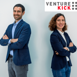 Frank Bonnet and Ana Hernando standing with the venture kick logo on the top